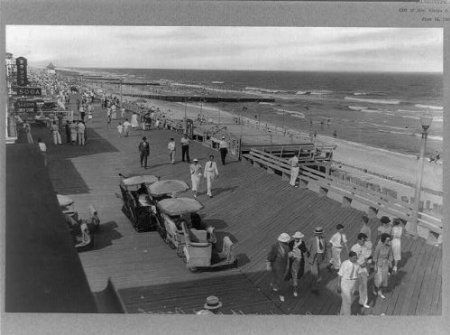 people walking down the ocean city boardwalk in 1920